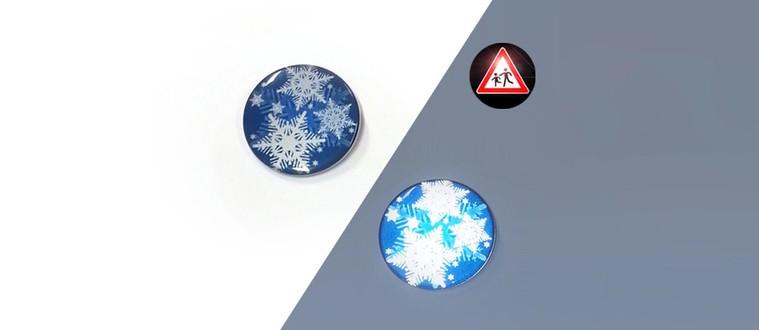 Reflektorbutton mit Schneeflocken, blau