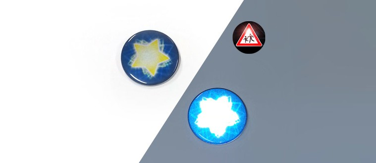 Reflektorbutton mit Stern, blau