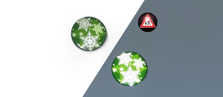 Spille catarifrangenti con falde di neve verdi